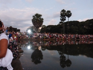 Tourists eagerly awaiting the sunrise in front of the lake at Angkor Wat